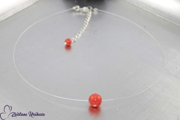 Singel, schwebende Perle in korallenfarben, unsichtbare Kette auch in anderen Farben möglich