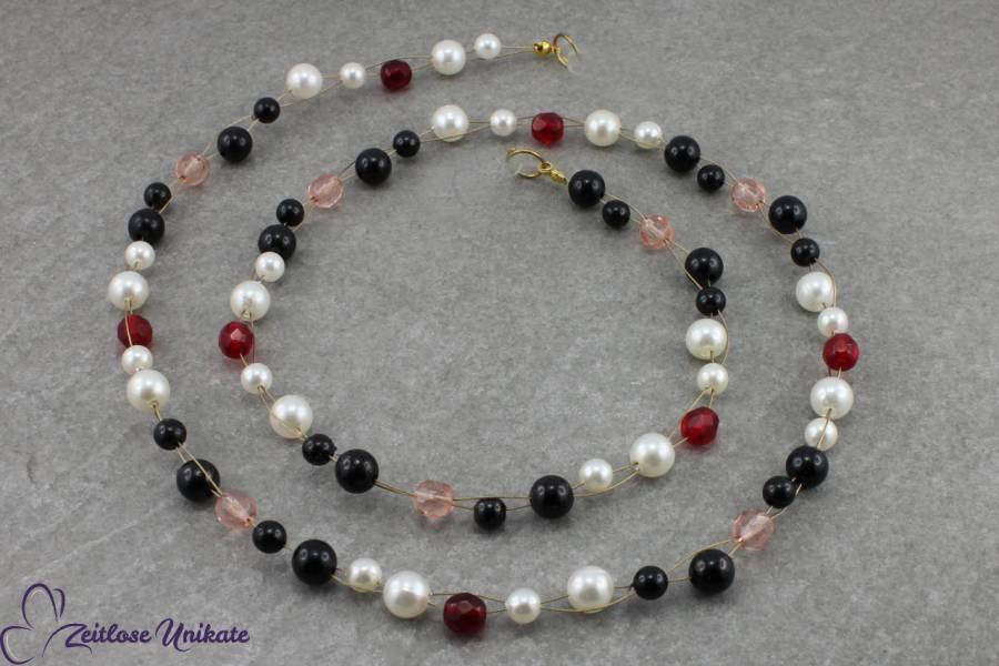 Brillenkette in schwarz rot weiß und rosa