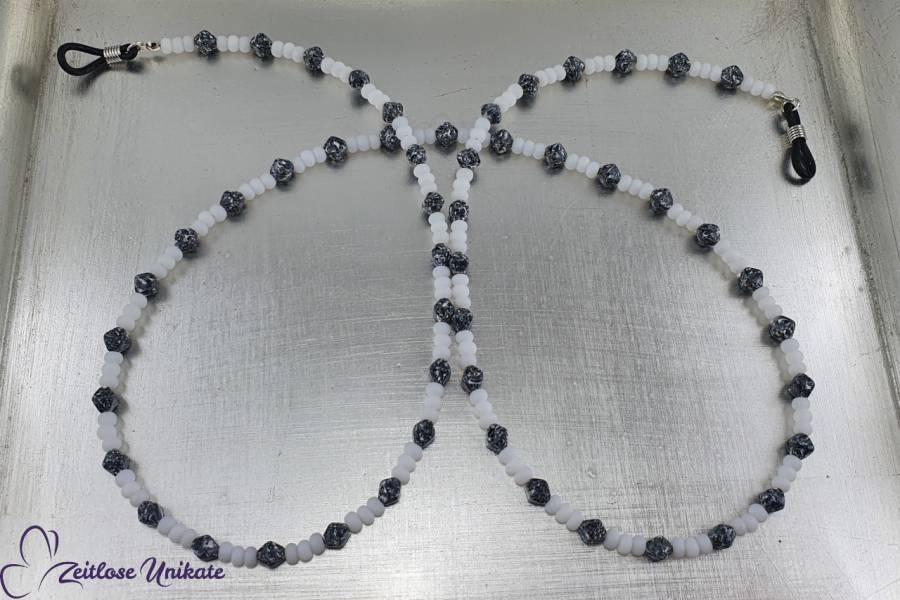 https://www.zeitlose-unikate.de/shop_cfg/Schmuck/1888-zeitlose-schwarz-weisse-brillenkette-perlen-wie-marmor.jpg